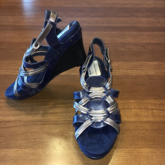 e7139ae092b9 AJ Valenci blue and silver sandals